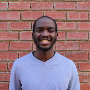 Staff Feature: From intern to program coordinator, Bevertone Anyonga talks about his journey to a career in community development