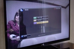 Arab American business owner Edna Zaid shows how her firm's videoconferencing system works in Commerce Twp.